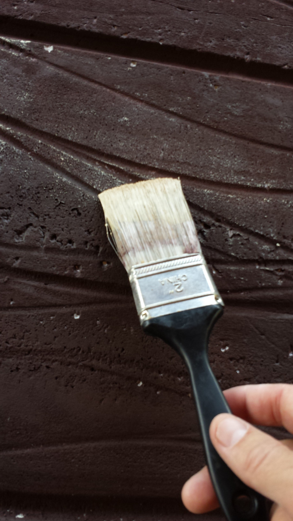 Drag the brush lightly across the grain to highlight it.